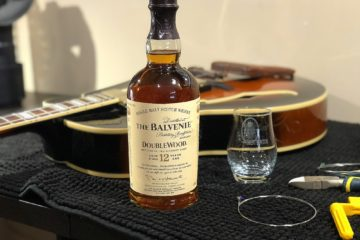 7 string guitar and a bottle of scotch